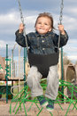 Free Young Boy Swinging Royalty Free Stock Images - 24269809
