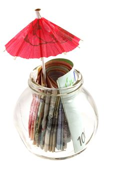 Paper Currency With Red Umbrella Royalty Free Stock Photos