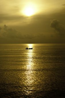 Tiny Boat In The Ocean Stock Image