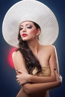 Attractive Cute Girl With Hat In Studio Stock Photography
