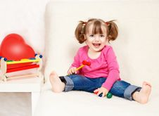 Free Little Girl Playing With Toys Stock Image - 24299621
