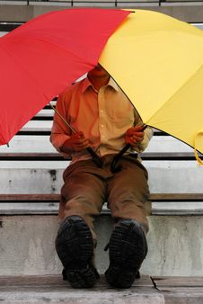 Free Red And Yellow Umbrella Man Royalty Free Stock Photography - 2430107