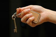 Free Outstretched Hand Holding Key Stock Image - 2437091