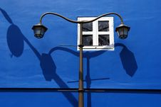 Free Blue Wall And Street Lamp Post Royalty Free Stock Photo - 2437325