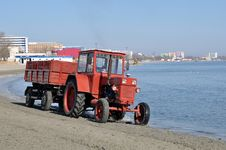 Free Tractor On Beach Stock Photography - 24304102
