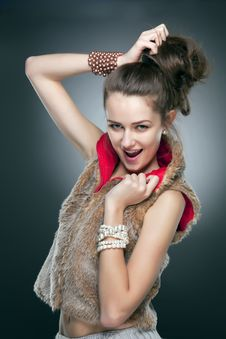 Free Beautiful Girl In A Fur Vest Stock Image - 24305081