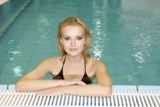Free Beautiful Young Woman Standing In A Swimming Pool Stock Images - 24306934