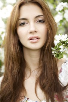 Free Brunette In The Garden Royalty Free Stock Images - 24306989