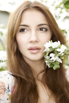 Free Brunette In The Garden Royalty Free Stock Image - 24306996