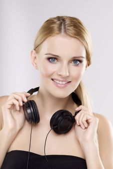 Free Beautiful Girl Is Listen To The Music Royalty Free Stock Image - 24307006