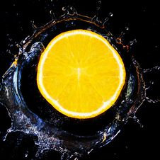 Free Slice Of Orange Falls Into The Water. Royalty Free Stock Photo - 24332995