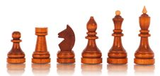 Chess. A Group Of Black Wooden Chess Pieces Royalty Free Stock Photography