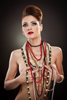 Free Portrait Of Beautiful Woman With Many Beads Royalty Free Stock Photos - 24338788