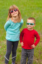 Free Brother And Sister With Sunglasses On Meadow Royalty Free Stock Images - 24343389