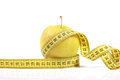 Free Diet Concept. Apple With Measuring Tape Stock Photography - 24351722