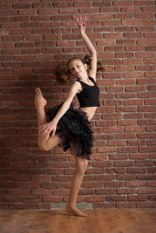 Free Girl Dancing Near Brick Wall Royalty Free Stock Image - 24350536