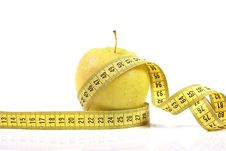Diet Concept. Apple With Measuring Tape Stock Photography