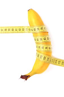 Diet Concept. Banana With Measuring Tape Royalty Free Stock Photo