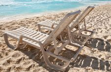 Free Two Sunbathing Chairs On The Beach Stock Photography - 24365182