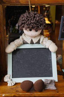 Rag Doll Holding Blackboard Stock Images