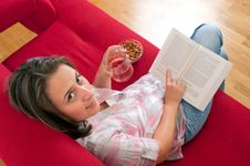 Free Young Woman Relaxing And Reading A Book Royalty Free Stock Photos - 24372468