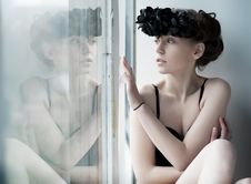 Free Melancholy - Lovely Girl Sitting By The Window Stock Photo - 24377680