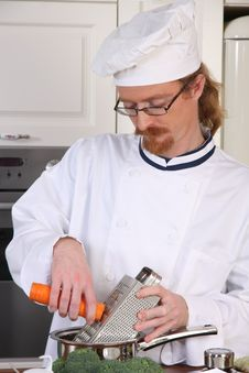 Free Young Chef Preparing Lunch In Kitchen Royalty Free Stock Photo - 24378175
