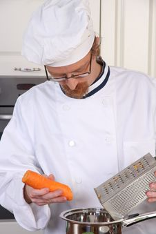 Free Young Chef Preparing Lunch In Kitchen Stock Photos - 24378183