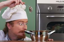 Free Chef Strange Looking At Pot Stock Photography - 24378232