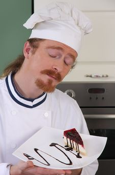 Free Chef Smelling A Piece Of Cake Stock Image - 24378261