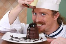 Free Chef Added Chocolate Sauce At Piece Of Cake Stock Photos - 24378333