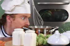 Free Chef Strange Looking At Pot Stock Photos - 24390343