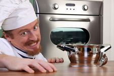 Free Young Chef With A Pot Stock Photography - 24390392