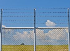Free Barbed Wire Fence. Royalty Free Stock Photos - 24394468