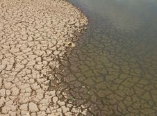 Free Cracked Soil In Water. Stock Photos - 24397623