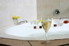 Free Glass Of Champagne On Bathtub. Royalty Free Stock Image - 2440416
