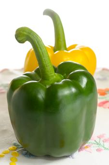 Free Sweet Peppers On Embroidered Tablecloth Stock Photo - 24403780