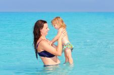 Happy Mother With Her Daughter On The Beach Stock Photography