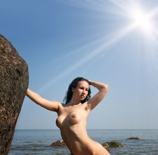 Nude Woman Against Sea And Blue Sky Royalty Free Stock Photos