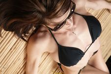 Free Sun Bathing Woman Black Bikini Tanning Herself Royalty Free Stock Photography - 24427117