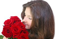 Free Girl Enjoys The Smell Of Roses Stock Photography - 24431712
