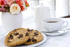 Cookie With Black Coffee And Flow Royalty Free Stock Photos