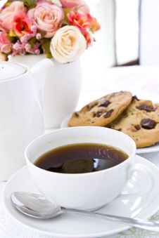 Cookie With Black Coffee And Flow Stock Photography