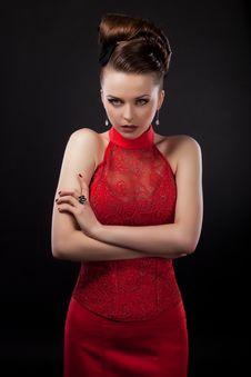 Successful Businesswoman In Fashion Dress Posing Stock Photo