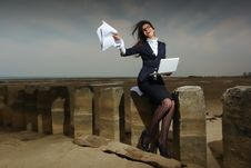 Free Business Lady Sitting On The Beach, On A Backgroun Royalty Free Stock Images - 24454509