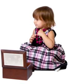 Free The Little Girl Opens A Box With A Beads Stock Photography - 24454812