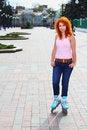Free Ginger Girl On Roller Skates Stock Photo - 24467040