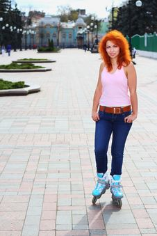Free Ginger Girl On Roller Skates Stock Photo - 24467040