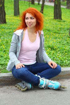 Free Relaxing Ginger Girl On Skates Stock Photography - 24467062