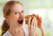 Free Young  Woman Eats Unhealthy Food, Burger Stock Photo - 24469720